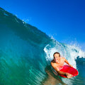 Young man body boarding Stock Photo