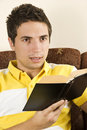 Young man with book Royalty Free Stock Photography