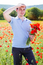 Young man with bouquet of poppies Royalty Free Stock Photo