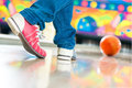 Young man bowling having fun in alley the sporty playing a ball in front of the tenpin alley Royalty Free Stock Image