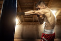 Young man boxing, exercise in the attic Royalty Free Stock Photo