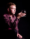 Young man with brandy glass Stock Image