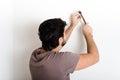 Young man bricolage hammering nail wall Royalty Free Stock Photo