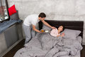 Young man bring breakfast for his wife in bed and wake her up wh Royalty Free Stock Photo