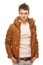 Young man in brown jacket Royalty Free Stock Photography