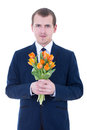 Young man with bunch of tulips in hands isolated on white Stock Image