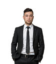 Young man a business suit, hands in his pockets, isolated on white background Royalty Free Stock Photo