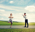 Young man and calm yoga woman emotional men women on the road Stock Photos