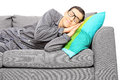 Young man calmly sleeping on a couch isolated white background Stock Images