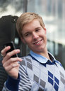 Young man with cameraphone Stock Photography