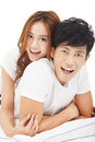 Young man carrying girlfriend in bed asian Royalty Free Stock Images