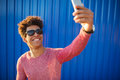 Young man in casual clothes make selfie over blue wall Royalty Free Stock Photo