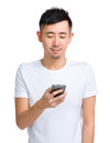 Young man check message on mobile phone Royalty Free Stock Photo