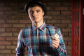 Young Man in Checkered Shirt Holding Smoking Pipe Royalty Free Stock Photo