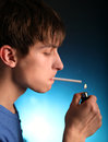 Young man with cigarette in the dark room Royalty Free Stock Image