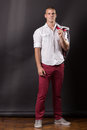 Young man classic posing portrait standing 20 years old pants sh Royalty Free Stock Photo