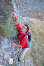 Young man climbing in mountain. Stock Photography