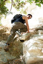 Young man climbing a is on a rock in the avakas gorge in akamas cyprus Stock Image
