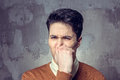 Young man closing nose Royalty Free Stock Photo