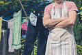 Young man by clothes line in garden Royalty Free Stock Photo