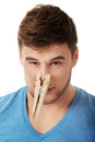 Young man with clothespin on his nose handsome Stock Photo