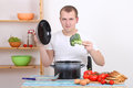 Young man cooking soup in the kitchen Royalty Free Stock Image