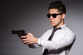 Young man in cool sunglasses holding gun isolated Royalty Free Stock Photo