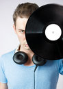 Young man covering his face with a vinyl disc Stock Image