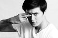 Young man covering one eye portrait of handsome with two fingers black and white style Royalty Free Stock Photos