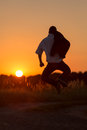 Young man cuts a caper jumps in the sundown Stock Photography