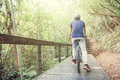 Young man cycling in the forest trail during weekend cold weather Stock Images