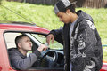 Young Man Dealing Drugs From Car Royalty Free Stock Photo