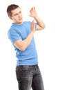 Young man defending himself with hands up Royalty Free Stock Photo