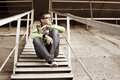 Young man in depression sitting on the steps Stock Photos