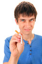 Young man destroy a cigarette on the white background focus on the hand Stock Photo