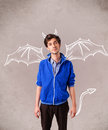 Young man with devil horns and wings drawing nasty Royalty Free Stock Photos
