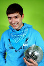 Young man with a discoball Royalty Free Stock Photography