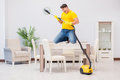 The young man doing chores at home Royalty Free Stock Photo