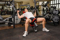 Young man doing Dumbbell Incline Bench Press workout in gym Royalty Free Stock Photo