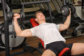 Young man doing Dumbbell Incline Bench Press workout in gym Stock Image