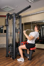 Young man doing lats pull down workout in gym handsome b Stock Photo