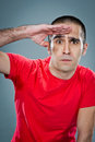 Young man doing a militar salute over grey background Stock Images