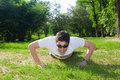 Young man doing push ups Stock Photo