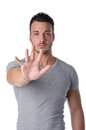 Young man doing stop gesture with his hand attractive and athletic isolated on white Royalty Free Stock Photography