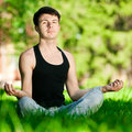 A young man doing yoga exercise Stock Images