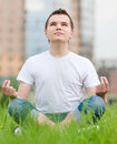 A young man doing yoga at park Royalty Free Stock Photography