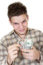 Young man dollars isolated white Stock Image