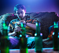 Young man drinking beer alone photo of a all by himself on couch Stock Photos