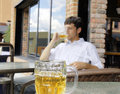 Young man drinking beer focus on front glass bock Stock Photo
