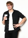 Young man drinking coffee portrait Stock Photography